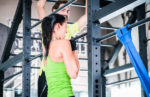 Watch this woman do a weighted pull-up with an extra 53 lbs.!